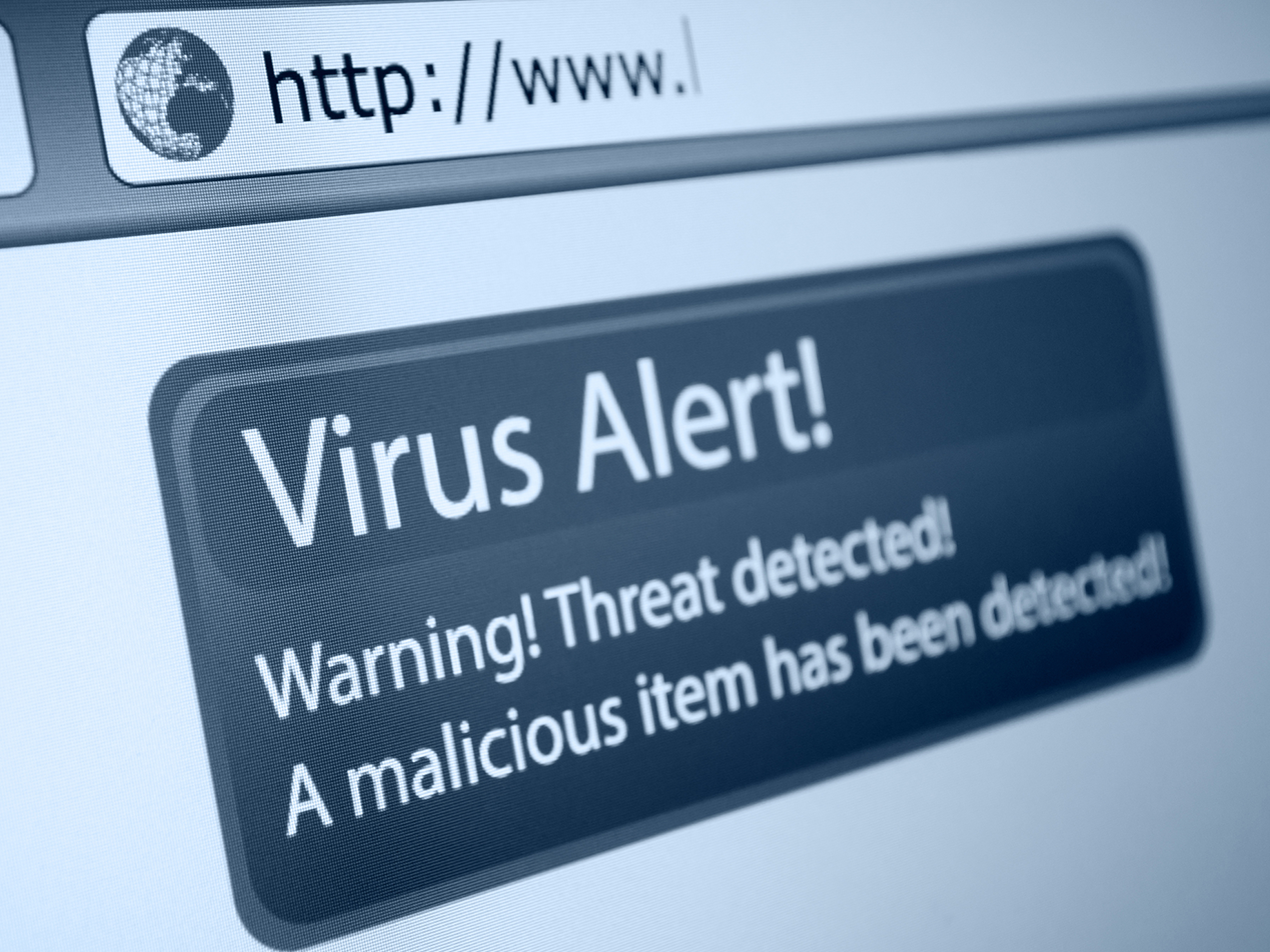 Internet browser with black rounded pop-up containing 'Virus Alert! Warning! Threat detected! A malicious item has been detected!' in white print.