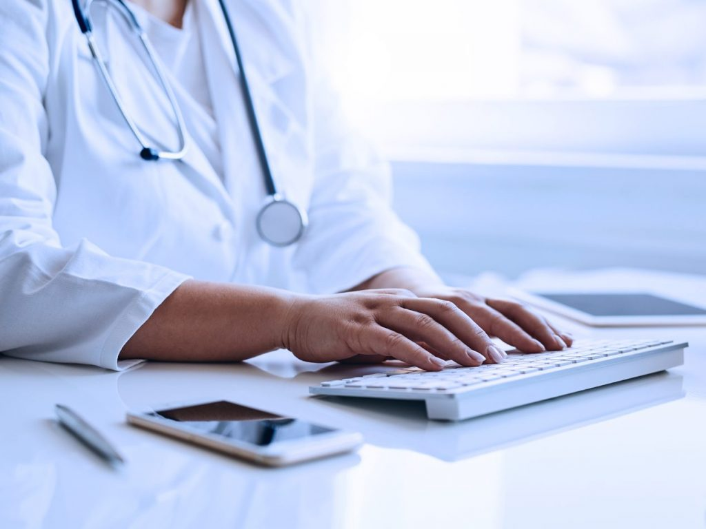 doctor typing hipaa compliant encrypted email