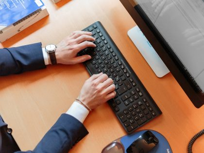 Business person typing on computer keyboard