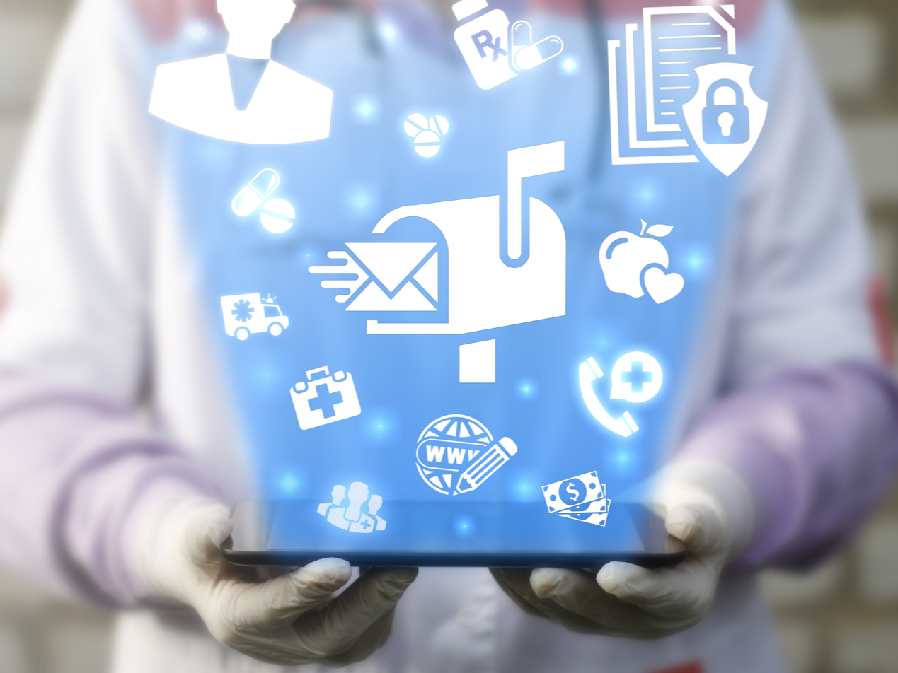 Email symbol surrounded by medical objects.