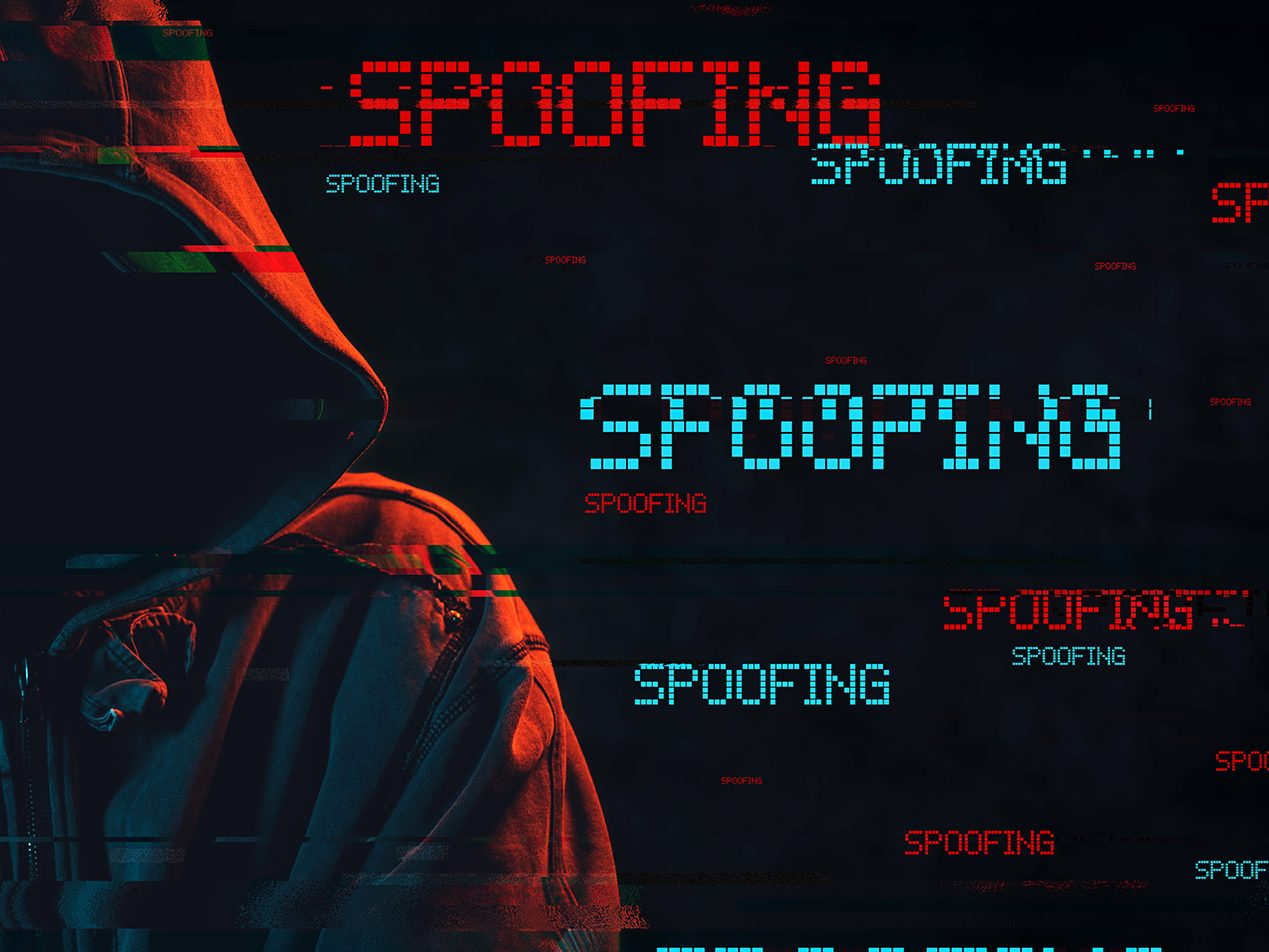Black background with dark hooded figure on the left and various sized red and light blue all caps 'SPOOFING' to his/her right.